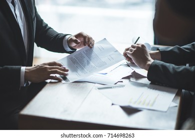Business man with suit Talking business model e-commerce sitting desk in office professional teamwork