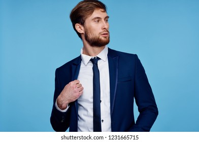 business man in a suit with a tie on a blue background