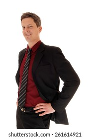 An business man in a suit and tie standing, with his hands on his hips,isolated for white background.
