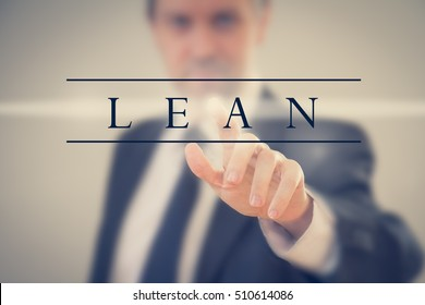 """Business man in a suit touching word """"Lean"""""""