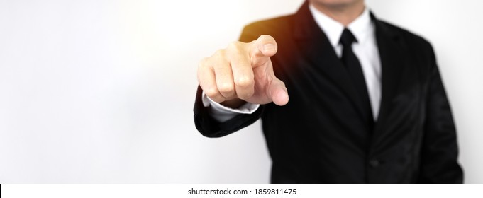 business man in a suit is using his index finger to direct or oppress on white background.