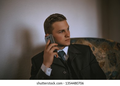 Business man in suit using smartphone . Concept of business phone call, communication, phone message, phone communication technology.