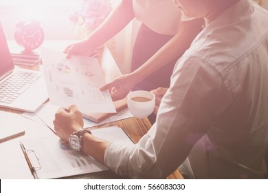 Business man supervising his secretaries to execute business plan with document and laptop  on desk. Boss advises female secretary about communication of manager and staff, checking job execution.