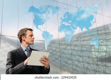 business man with tablet world map cloud computing global communication concept