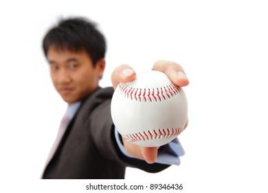 Business man take baseball with Self confident smile