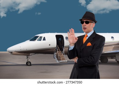 Business man talking next to a private jet