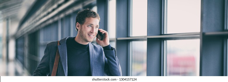 Business man talking on phone walking in airport using smartphone 5g tech device banner panorama - young businessman commute lifestyle panoramic background.