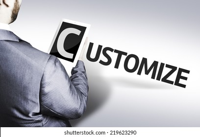 Business man with the text Customize in a concept image