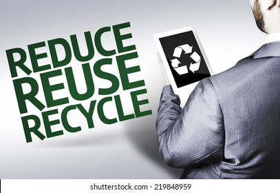 Business man with the text Reduce Reuse Recycle in a concept image