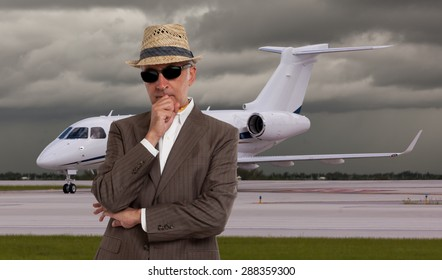 Business man thinking in front of private airplane