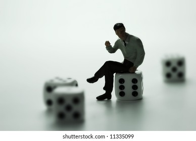 A business man thinking on dice.