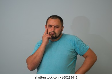 Business man thinking over solving a problem, isolated on a gray background