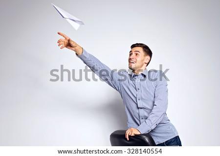 business-man-throwing-paper-plane-450w-328140554.jpg