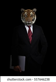 business man with tiger head in the dark