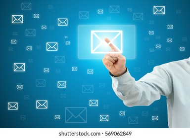 Business man touch a button EMAIL on an imaginary screen