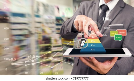 Business man touch the graph report on tablet in super store for Business growth