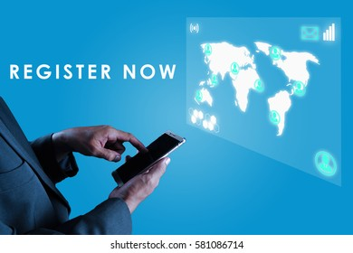a business man touching his smart phone and an imaginary screen in front him with text REGISTER NOW