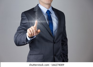 Business man touching an imaginary screen