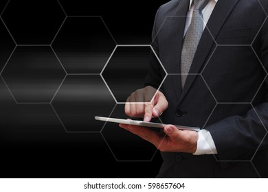 Business man touching modern tablet with virtual panel of icon polygon interface , business concept