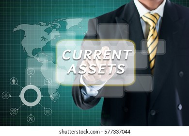 BUSINESS MAN TOUCHING ON DIGITAL SCREEN WRITE  CURRENT ASSETS.