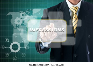 BUSINESS MAN TOUCHING ON DIGITAL SCREEN WRITE  IMPRESSIONS.