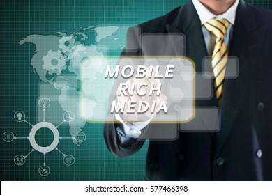 BUSINESS MAN TOUCHING ON DIGITAL SCREEN WRITE  MOBILE RICH MEDIA.