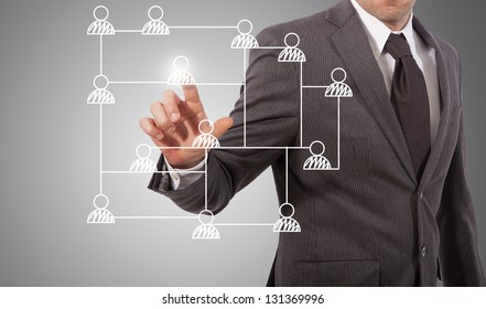 business man touching social network structure, grey background