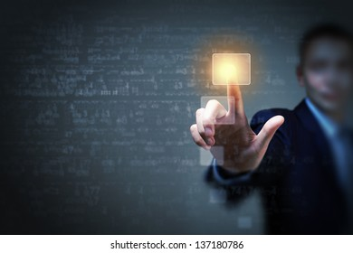Business man touching virtual display. Business and technology concept