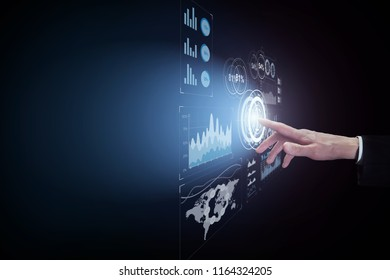 Business man touching virtual interface button on dark background