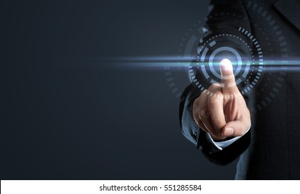 Business man touching virtual interface button on dark background with copy space