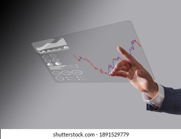 Business man toucing screen and showing holographic graphs and stock market statistics gain profits. Concept of growth planning and business strategy. Display of good economy form digital screen.
