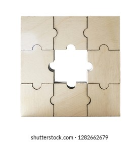 business man try to build wood block on wooden table  background business organization startup concept. missing part in the center
