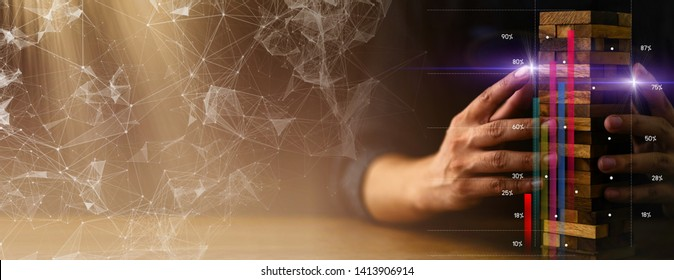 business man try to build wood block on wooden table and black background business organization strategy startup concept