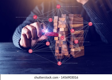 business man try to choose wood block from others on wooden table and black background business organization startup concept