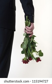 business man trying to give someone flowers