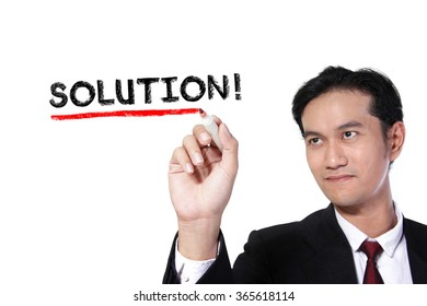 """Business man underlining the word """"Solution"""" on screen, over white background"""
