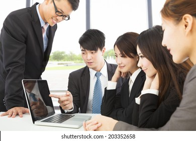 business man use laptop to present report to colleague