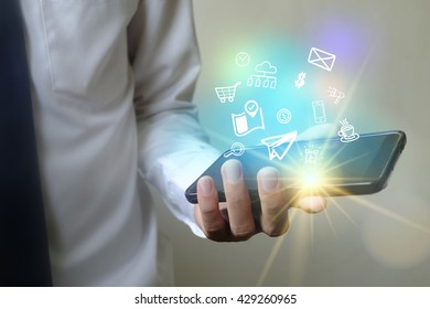 business man using application software icons on mobile phone , business social media concept