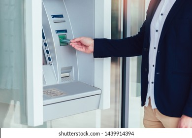 Business man using ATM. Person using credit card to withdrawing money from atm machine.