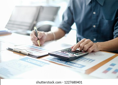 Business man using calculator working at office with reports document financial.