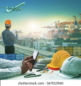business man using computer tablet on working table in container dock  with transportation background