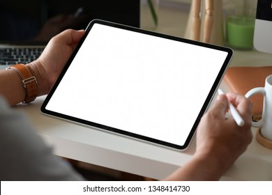 Business man using digital tablet on workspace