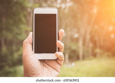 business man using his mobile phone in outdoor