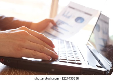 business man using laptop computer on office desk
