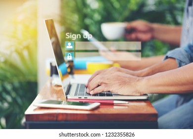 Business man using laptop computer and sign up or log in username password in coffee shop,GDPR.cyber security and privacy concept