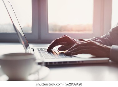 Business man using laptop computer at home. Male hand typing on laptop keyboard in office. Businessman, student, work from home, distance education, online learning, studying concept
