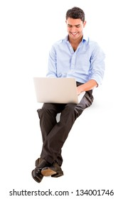 Business man using a laptop - isolated over a white background