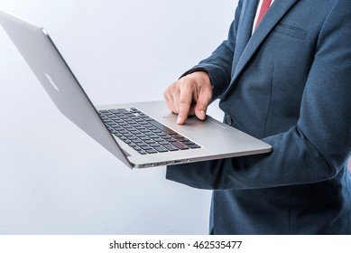 Business man using laptop with white background