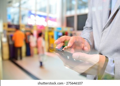 Business Man using Mobile Digital smartphone in Business Center as Online Financial activity or Mobile Banking concept with ATM Background.  Double Exposure effect applied.