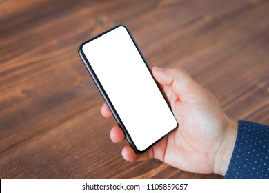 Business man using mobile phone with blank empty screen.